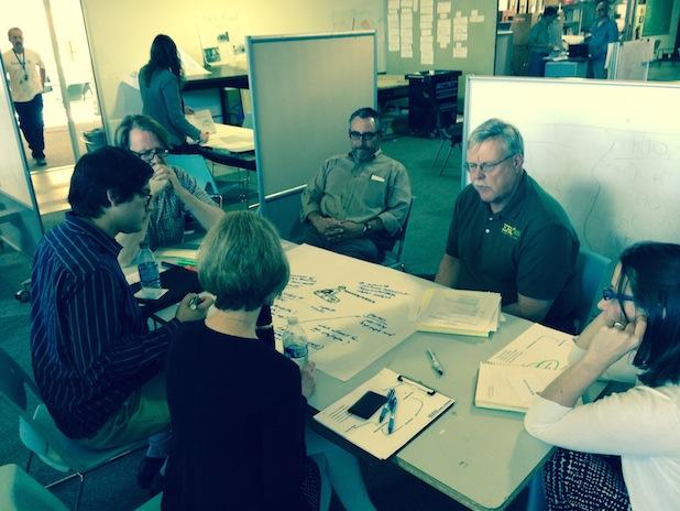 Participants discussion designing new metrics.