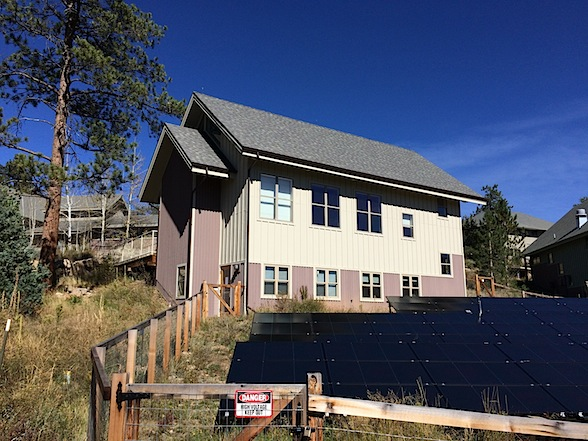 One Room Schoolhouse with Solar panels in foreground