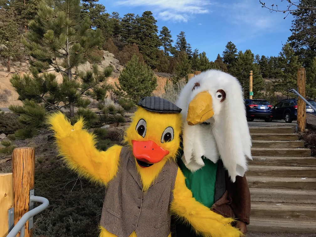 Quilten T. Canvasback (the official Estes Park Duck Race mascot) poses for a cameo with Eagle Rock's mascot.